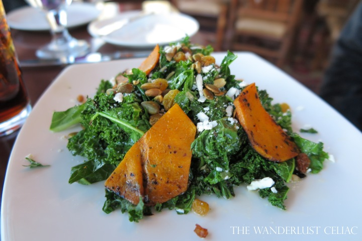 Warmed Kale Salad with butternut squash, pumpkin seeds, golden raisins, ricotta, and a maple vinaigrette.
